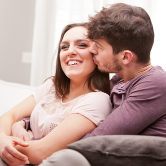 man kisses softly a happy woman